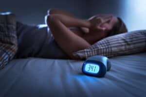 woman trying to go to sleep when stressed
